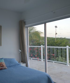 Apartment below pool deck -Bedroom 6with spectacular views of the Caribbean Sea and garden